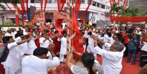 Cultural activists performing near the red flag